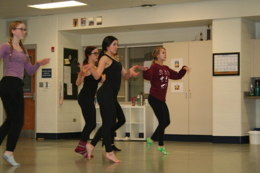 Dance members rehearse.