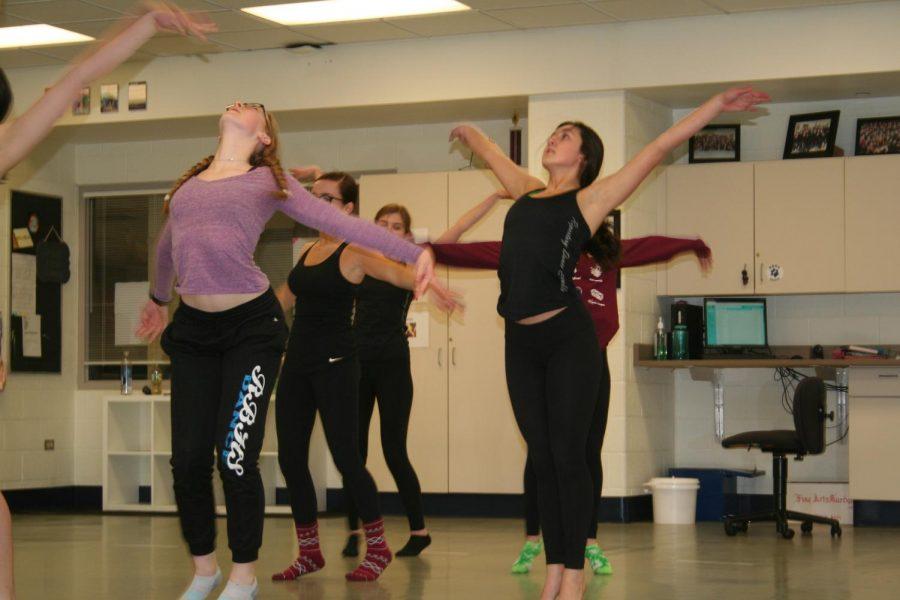 Dance members rehearse.