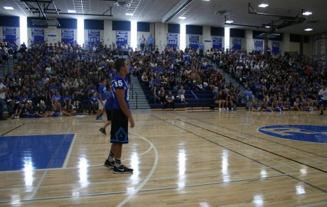 Students play dodge ball against teachers at the homecoming pep rally.
