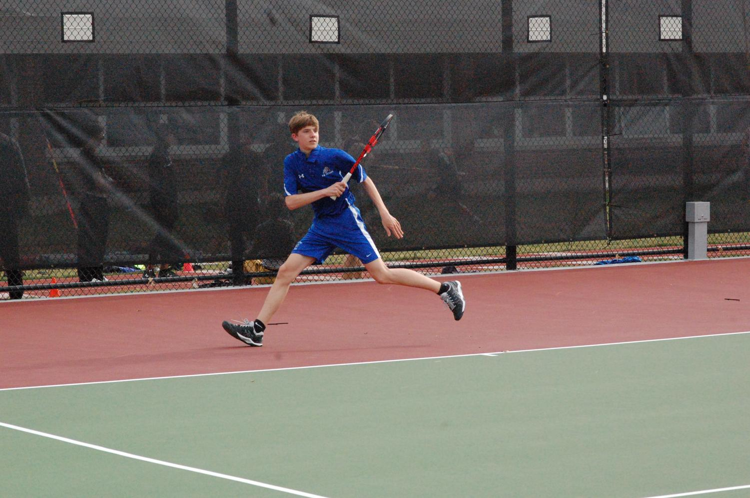 Boys' tennis in action.