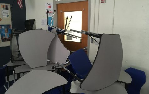 Chairs barricade the door during a lockdown drill.