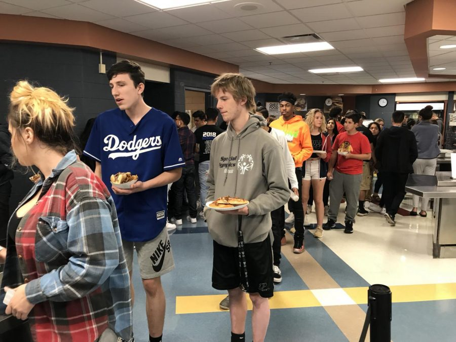 Students waiting in line to get their lunches.