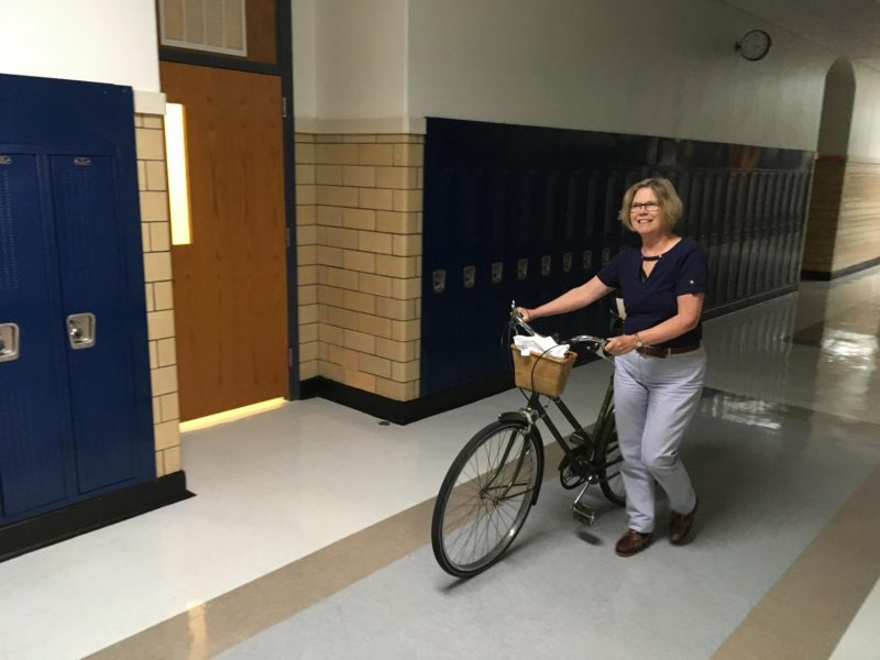 Noelle Bajohr walks her bike through the halls as she heads home for the day.