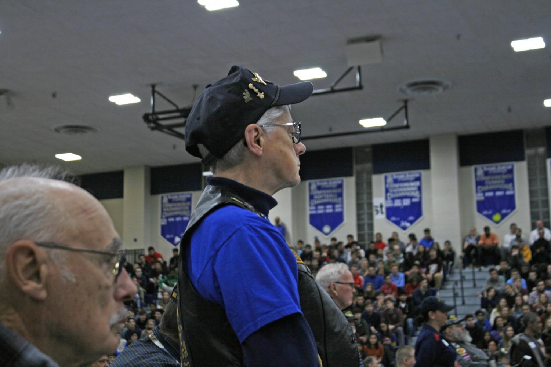 Veteran rises for their service anthem.