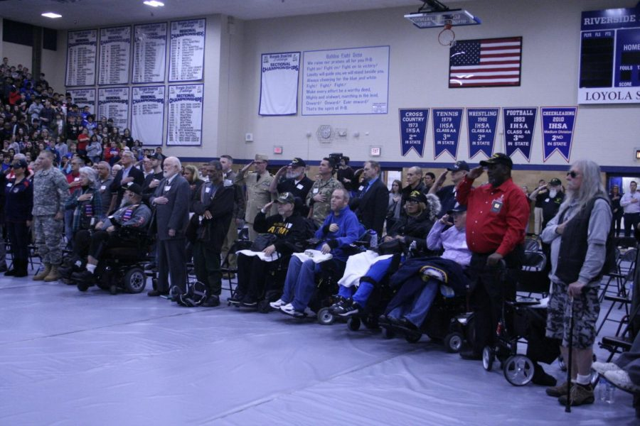 Veterans being honored during the assembly.