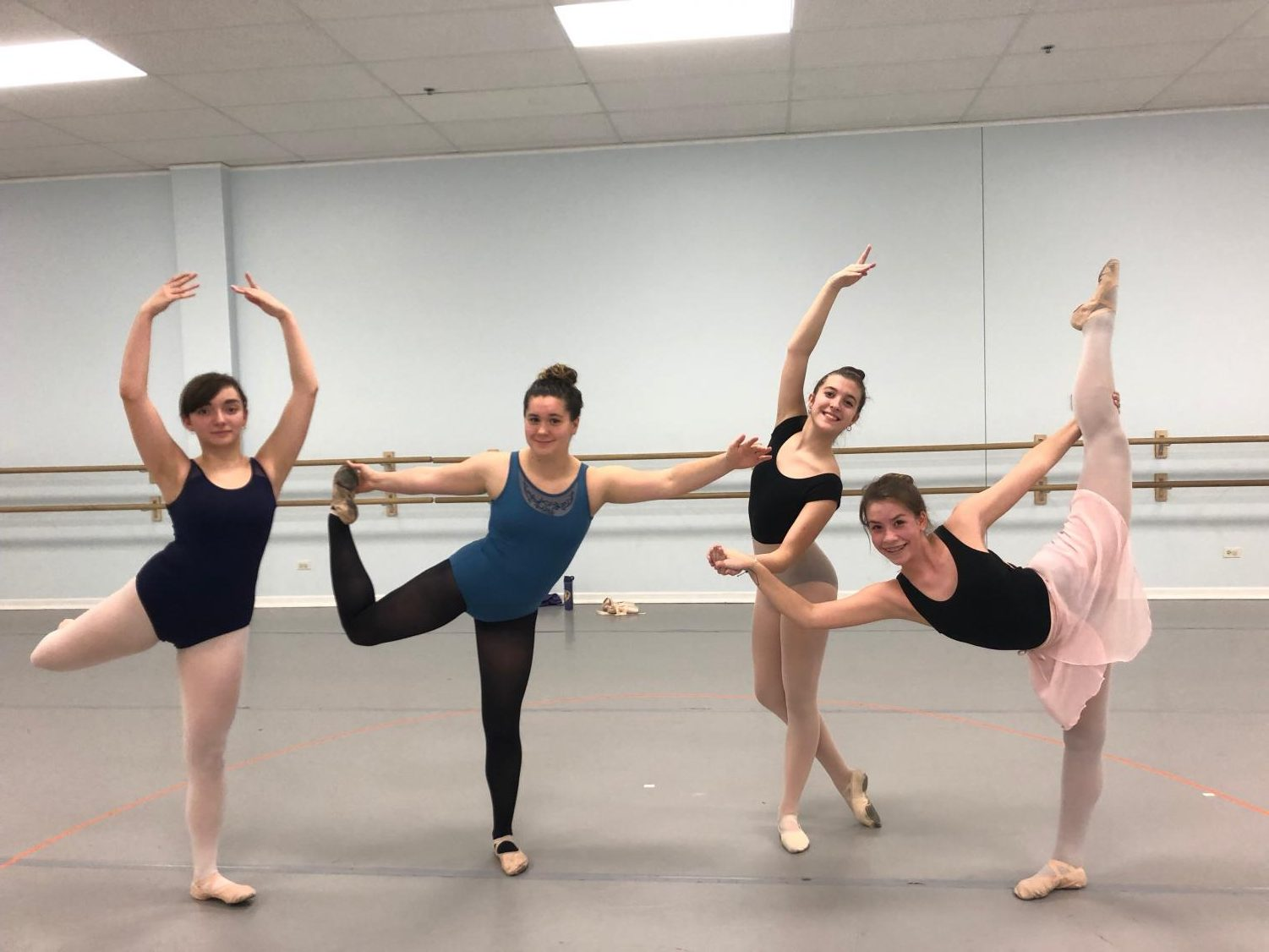 Sarah attempting to do ballet with dancers in the class.