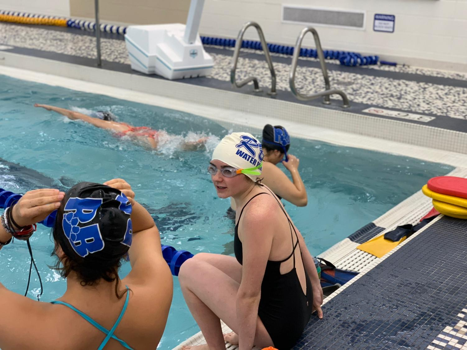 Bella anxiously entering the pool during practice.