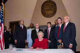 Alabama Gov. Kay Ivey signs restrictive abortion bill.