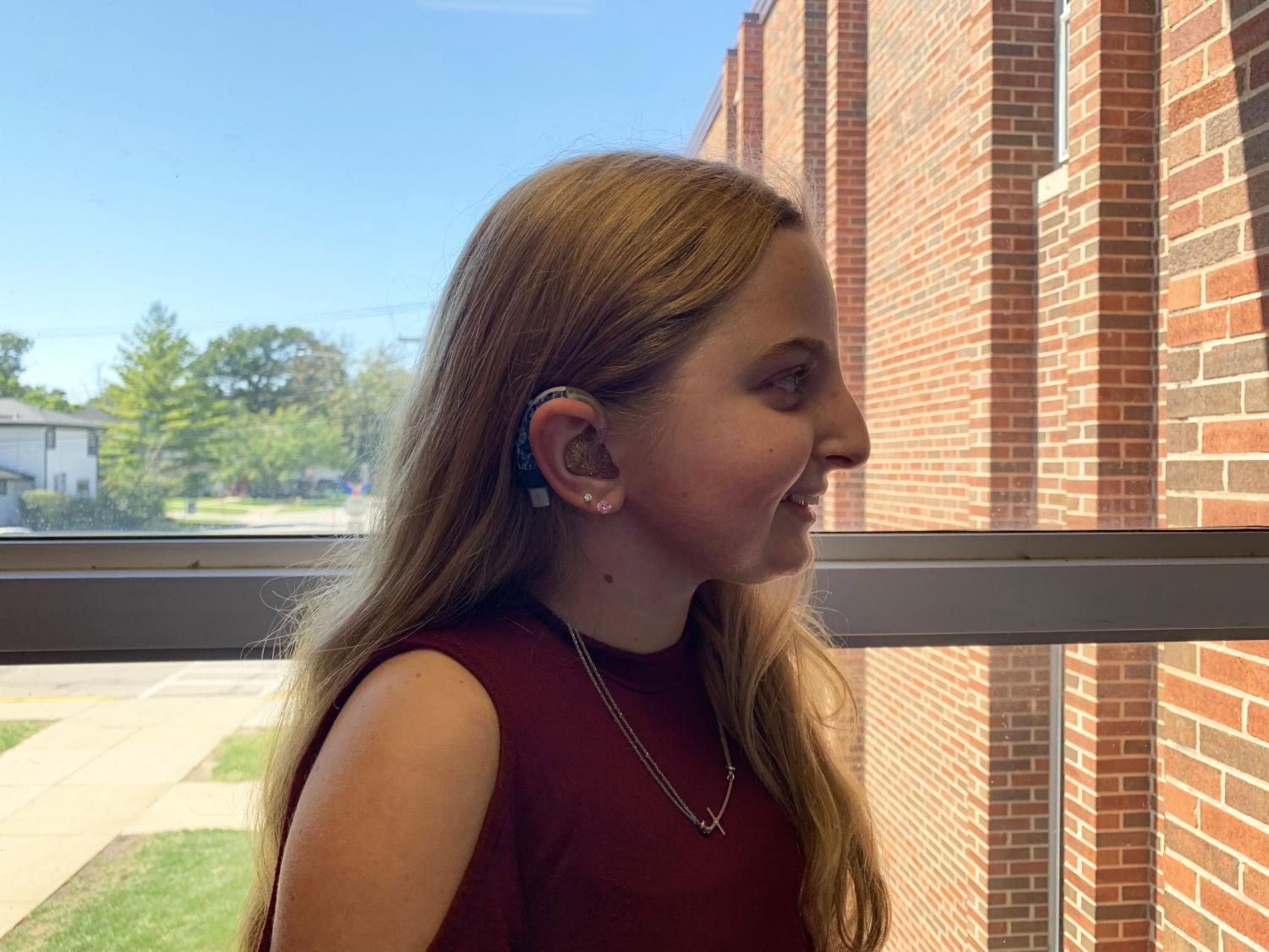 Ashley Whigam, RBHS junior, is proud of her hearing aids.