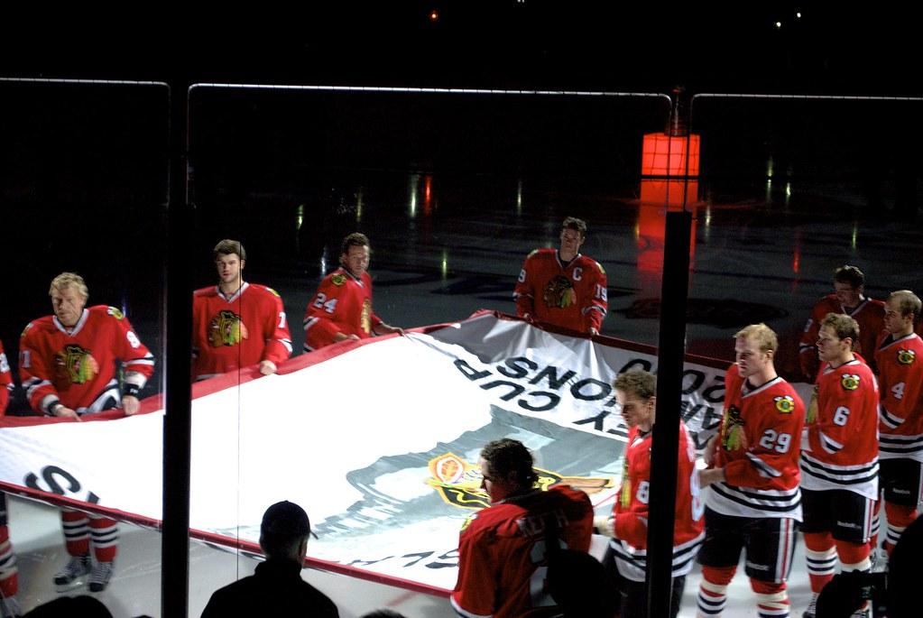 Blackhawks players raising Stanley Cup Banner