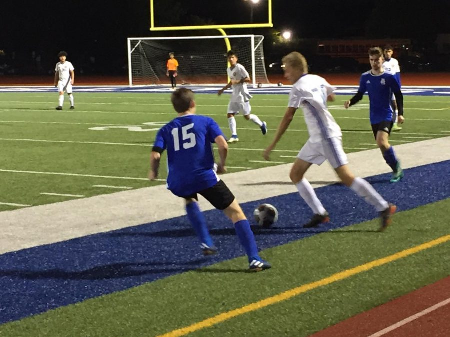 Senior Ryan Power attempts to take the ball away from a Kennedy player