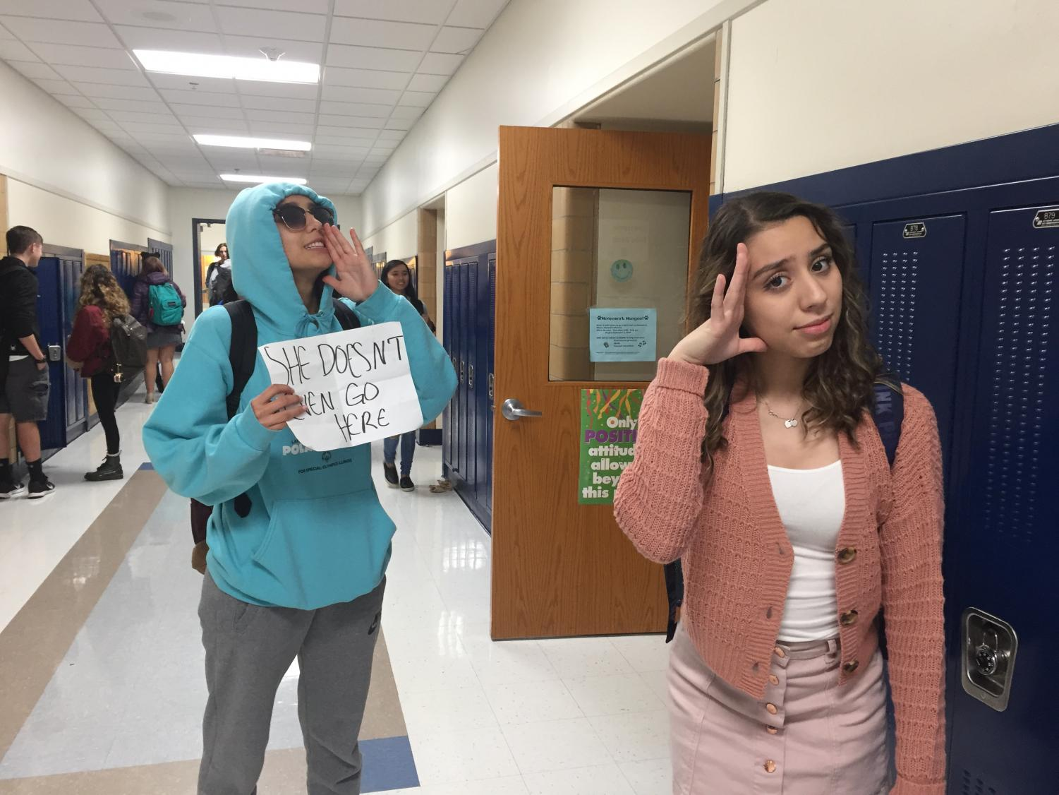 Homecoming Queen senior Cassandra Hines and junior Daniela Ulloa, dressed up for Thursday's Hollywood Celebrity theme as Damian and Gretchen from Mean Girls.