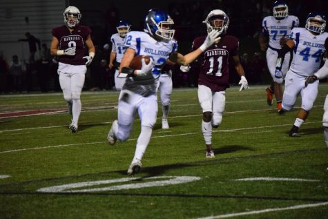 Chris Doherty runs for a touchdown against Wheaton Academy.