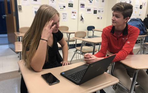 Students Claire Schroeder and Simon Roth talk about assignments in class.