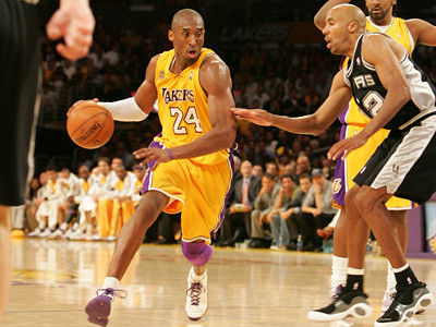 Kobe Bryant playing for the Lakers wearing his famous number 24 jersey.