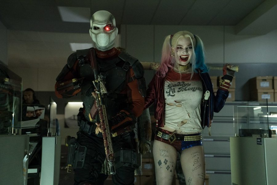 Harley Quinn, played by Margot Robbie, standing next to Deadshot, played by Will Smith in the movie