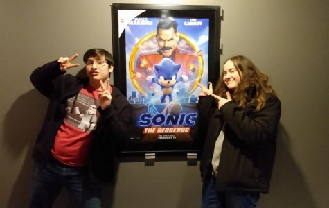 William and Mali show their excitement in front of the Sonic Movie poster.