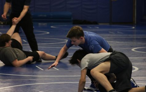 Two wrestlers practicing in preparation for their Sectionals competition, including state qualifier Quintin Godlewski.