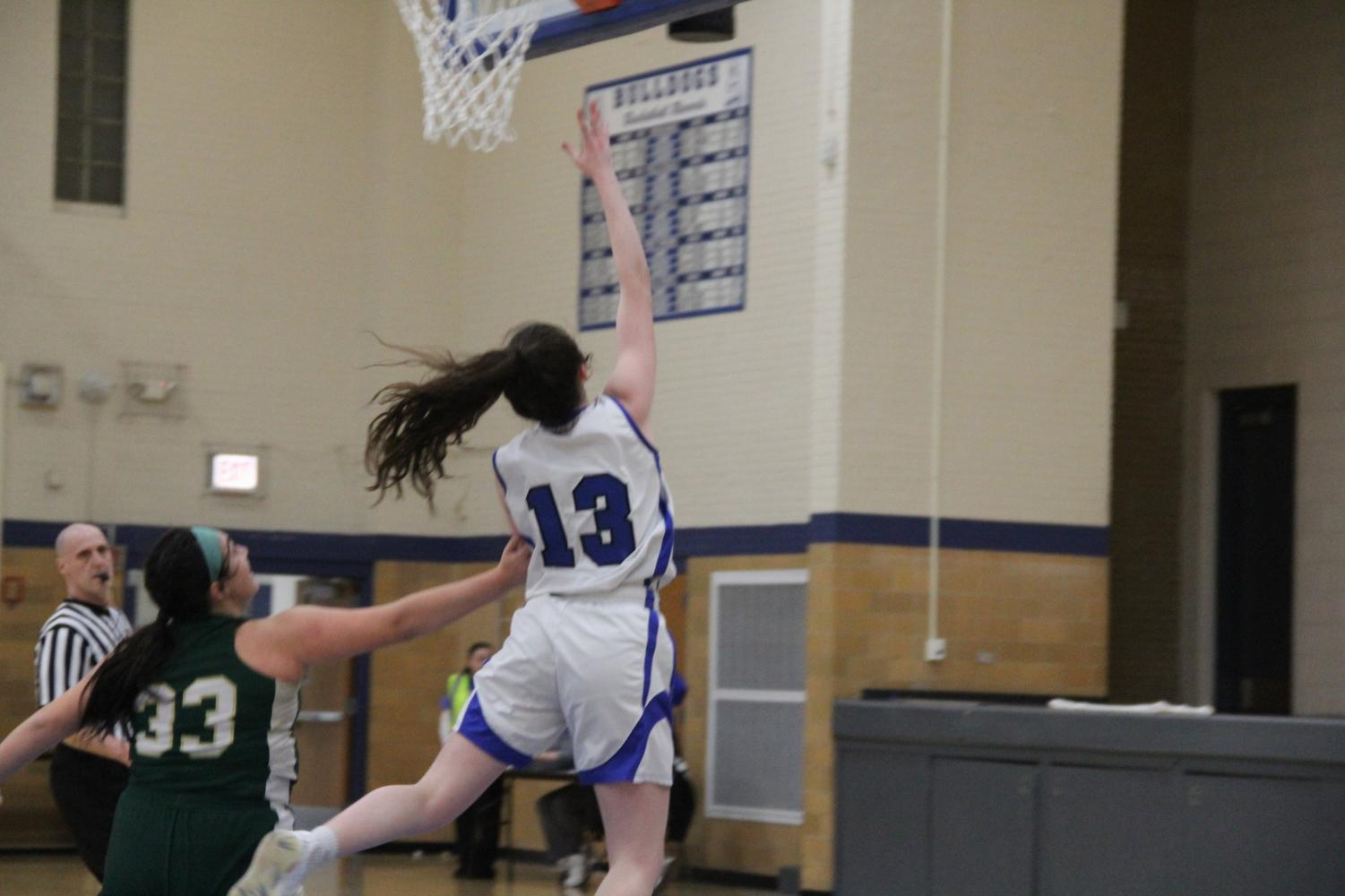 Junior Brenna Loftus going up for a layup.               ‎‏‏‎ ‎‏‏‎ ‎‏‏‎ ‎‏‏‎ ‎‏‏‎ ‎‏‏‎ ‎Photo courtesy of Rouser.