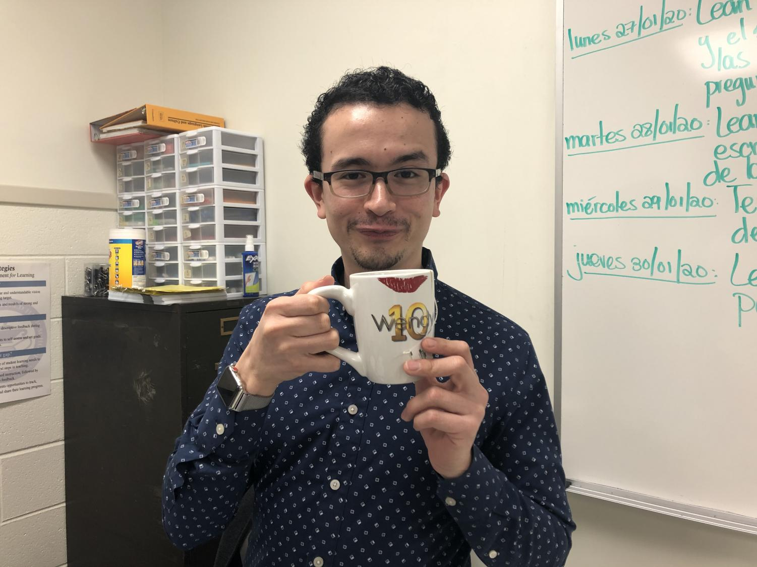 Juan Tinoco making one of his signature reaction faces while holding his Wendy Williams mug.