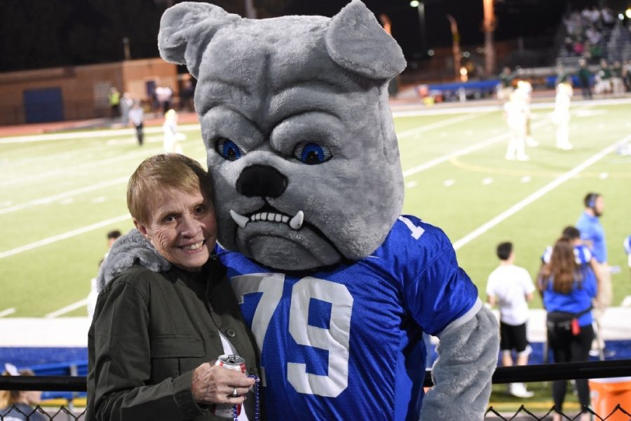 Jahnke+posing+with+the+RBHS+bulldog+mascot+at+one+of+the+football+games.+