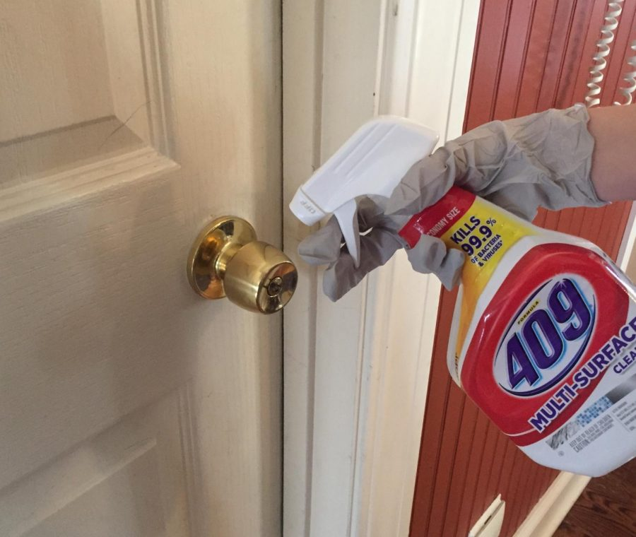 Kenna, at home, cleaning doorknobs with 409 cleaner and waiting for this to be over.