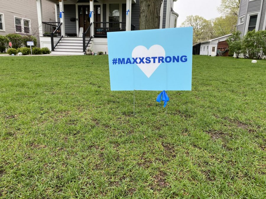 The signature #MaxxStrong sign.