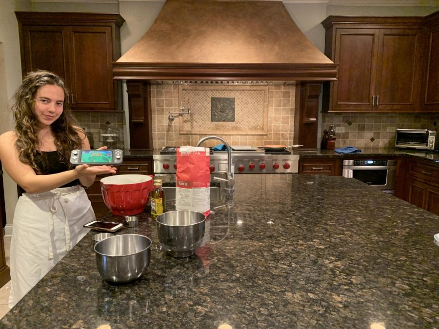 Quinn Palermo playing ACNH while making a sourdough starter. Photo courtesy of Kim Palermo