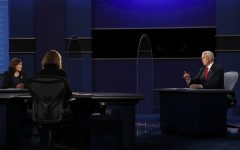 Harris (left) and Pence (right) engage in the traditional single debate between the major party nominees for the Vice Presidency while Page (center) moderates the debate.