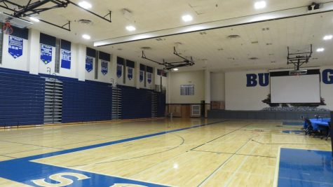 The empty bleachers and court in the RB main gym.