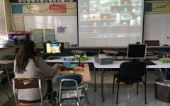 Ms. Cassens projecting her class during remote learning.