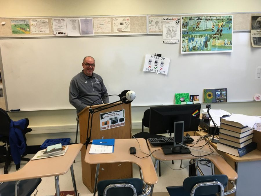 Mr. Forberg prefers to teach sitting at his podium.