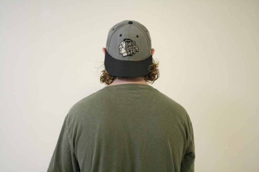 Student wearing a backwards hat.
