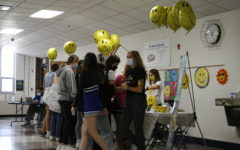 Students participating in World Smile Day activities.